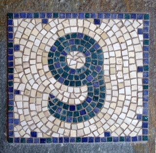 House number on stone slab. Photo: Helen Miles Mosaics
