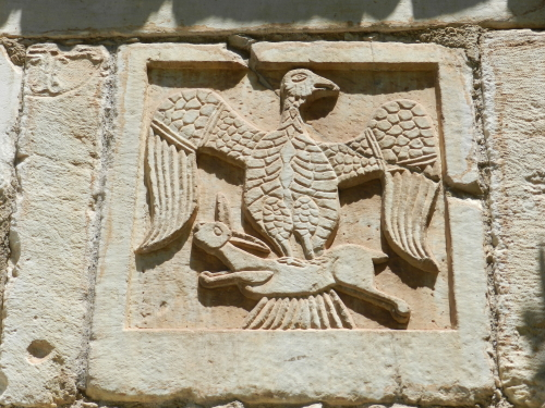 Eagle and hare stone carving. Mystras, Greece.