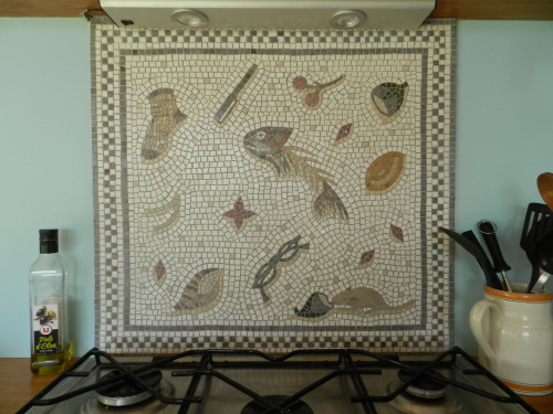'Unswept floor' mosaic installed as kitchen splash back