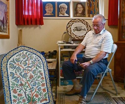 Malcolm Skipp and some of his mosaic works