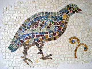 Bird, fragment. Based on a 6th century mosaic from Madaba, Jordan. 28cm x 23cm. Marble, stone, millefiori with pebbles cast in metal frame. Indoor or outdoor.