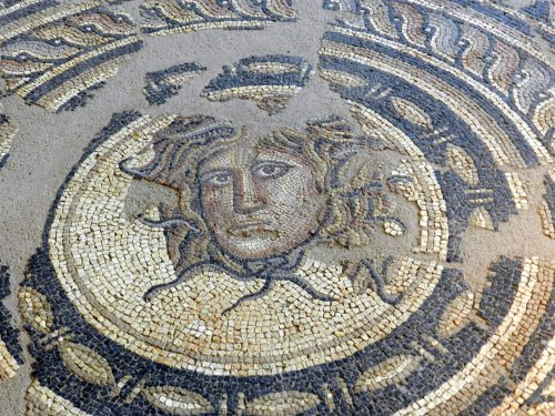 A collection of ancient mosaic Medusa heads.