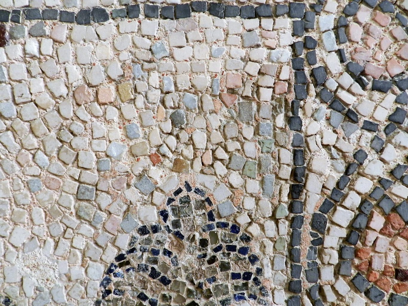 Mixing of coloured stones. Mosaics of San Giovanni Evangelista, Ravenna