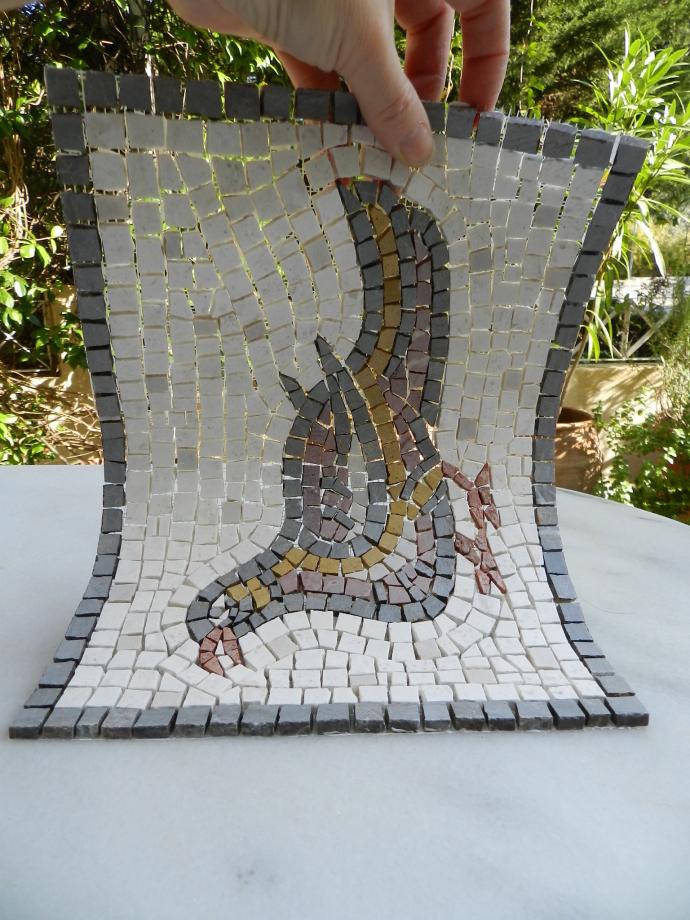 Mosaic bird on mesh