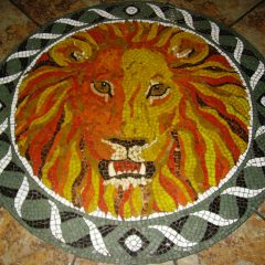 Lion head floor mosaic by Tamara Froud