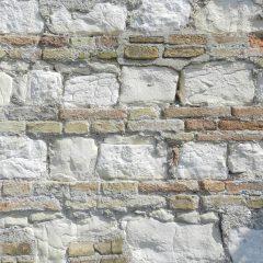 Wall with brick and stone, Ancona, Italy.