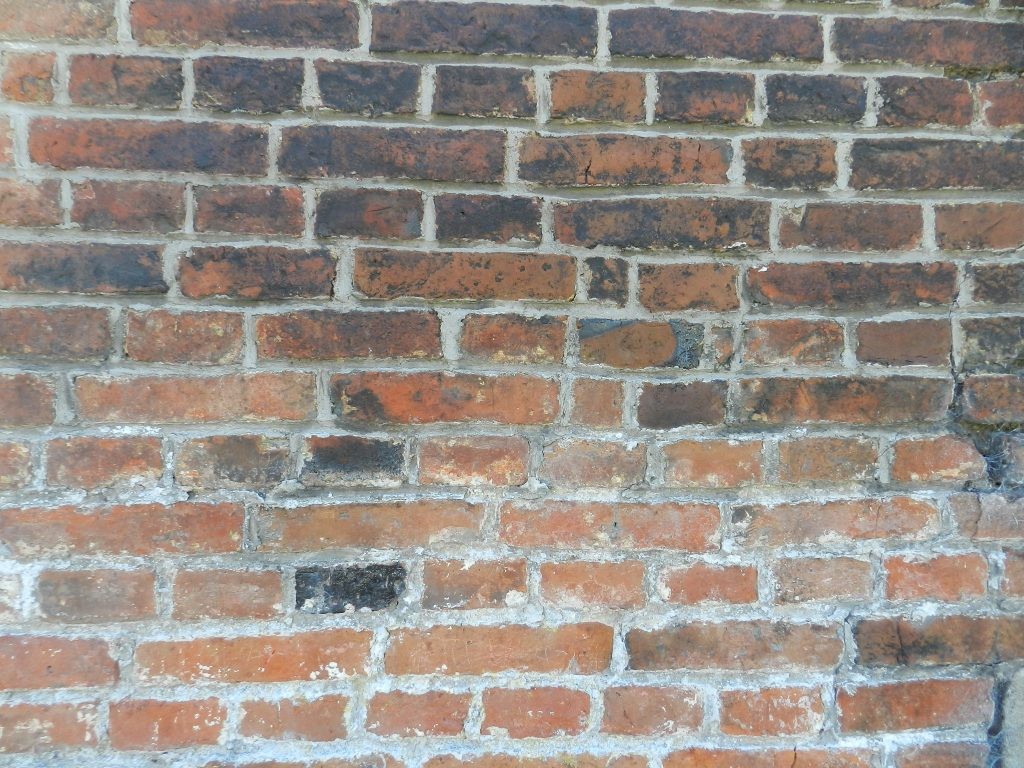 Brick wall, Normandy, France.