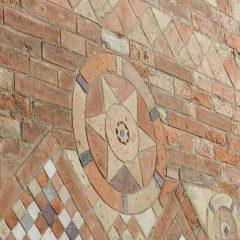 Wall with decorative brick, Bologna, Italy.