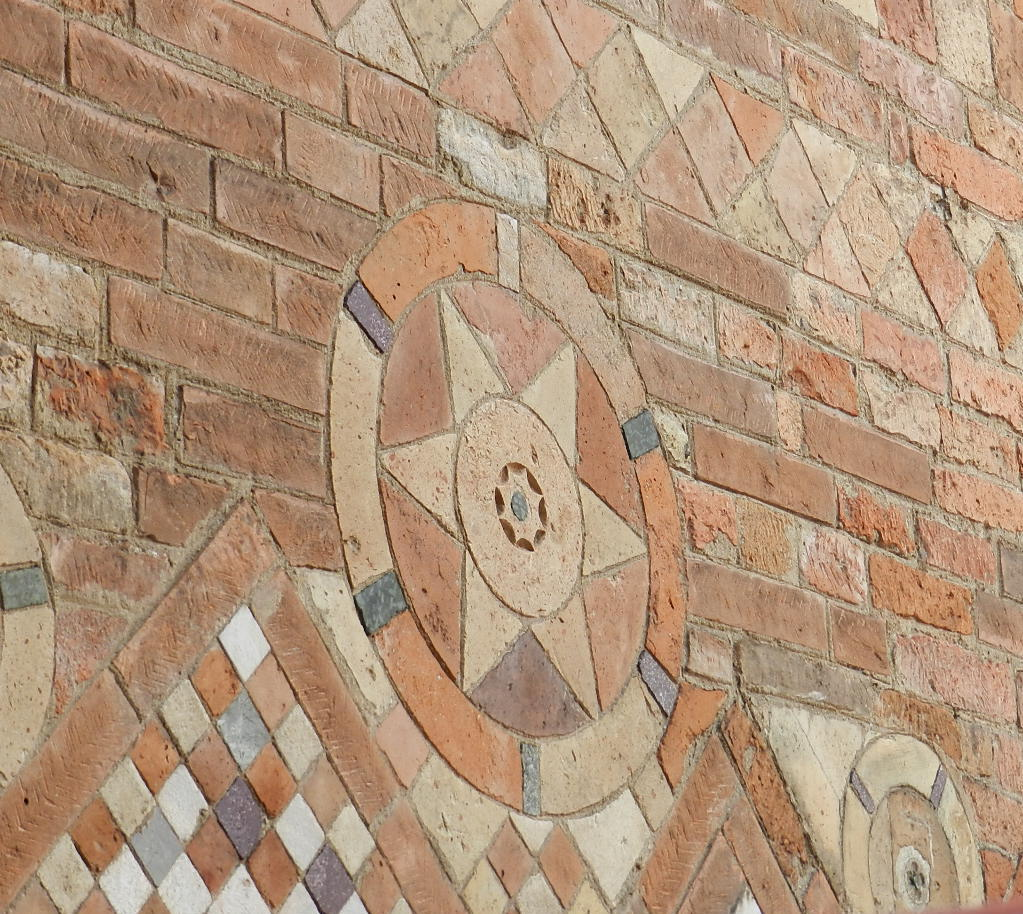 Wall with decorative brick, Bologna, Italy.