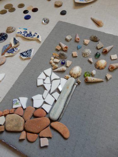 laying out mosaic materials