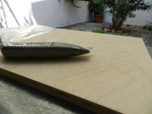 Scoring of MDF boards with stanley knife.