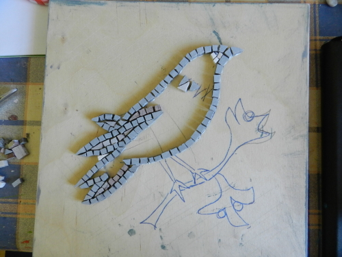 Stick down the outline of the mosaic first.