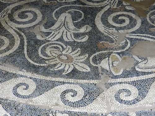 Decorative floral pebble mosaics. Pella, Greece.