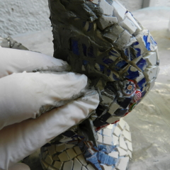 3d mosaic - pushing grout into the interstices.