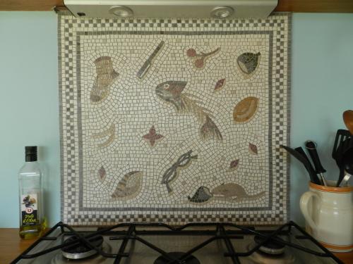 'Unswept floor' mosaic installed as kitchen splash back