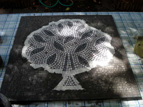 The mosaic making process: grouting the background