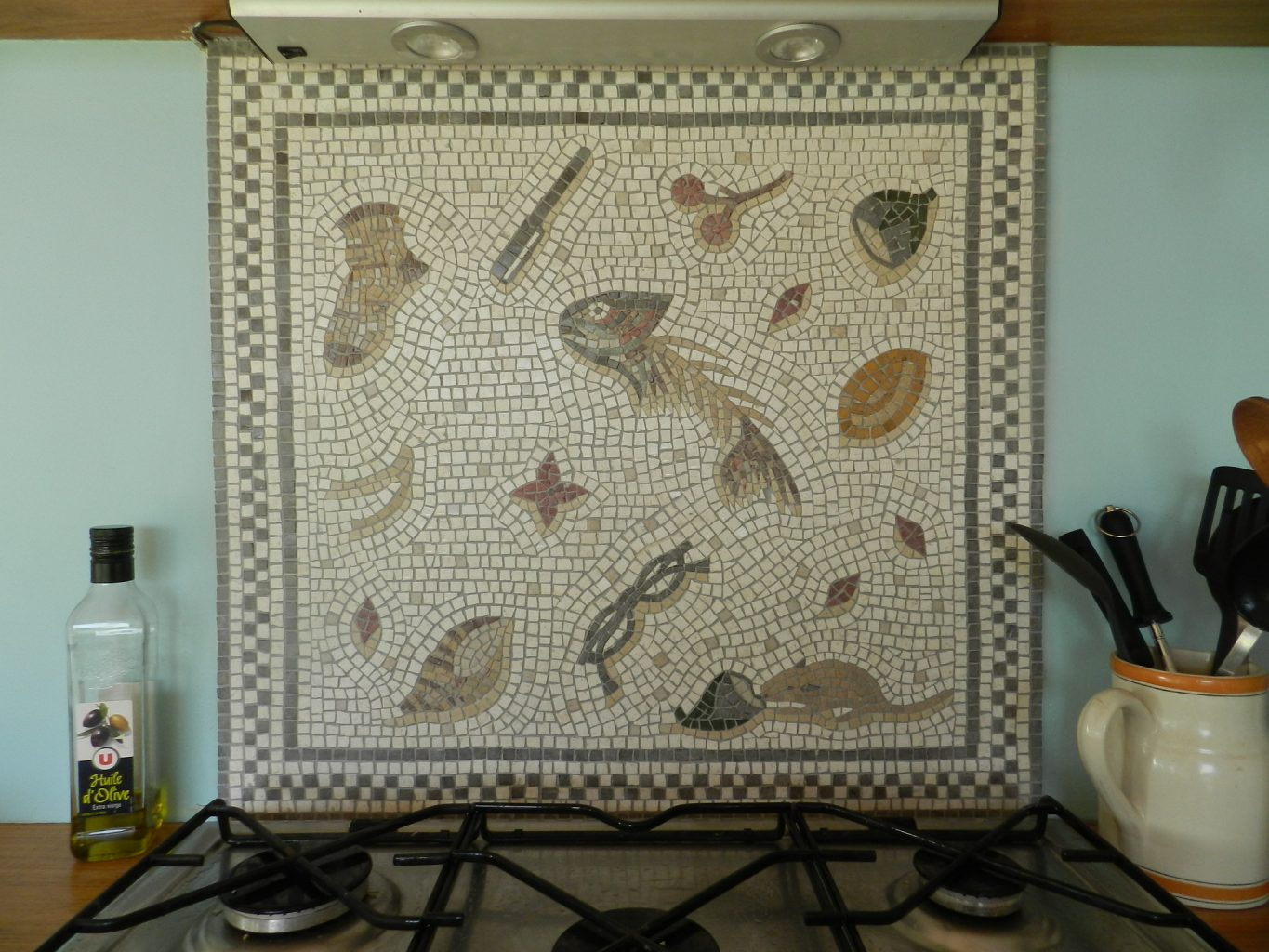 Installing a mosaic splash back in seven easy steps.