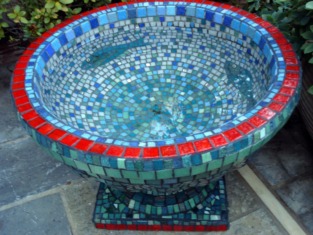 Mosaic garden urn decorated with vitreous glass, mirror and millefiori.