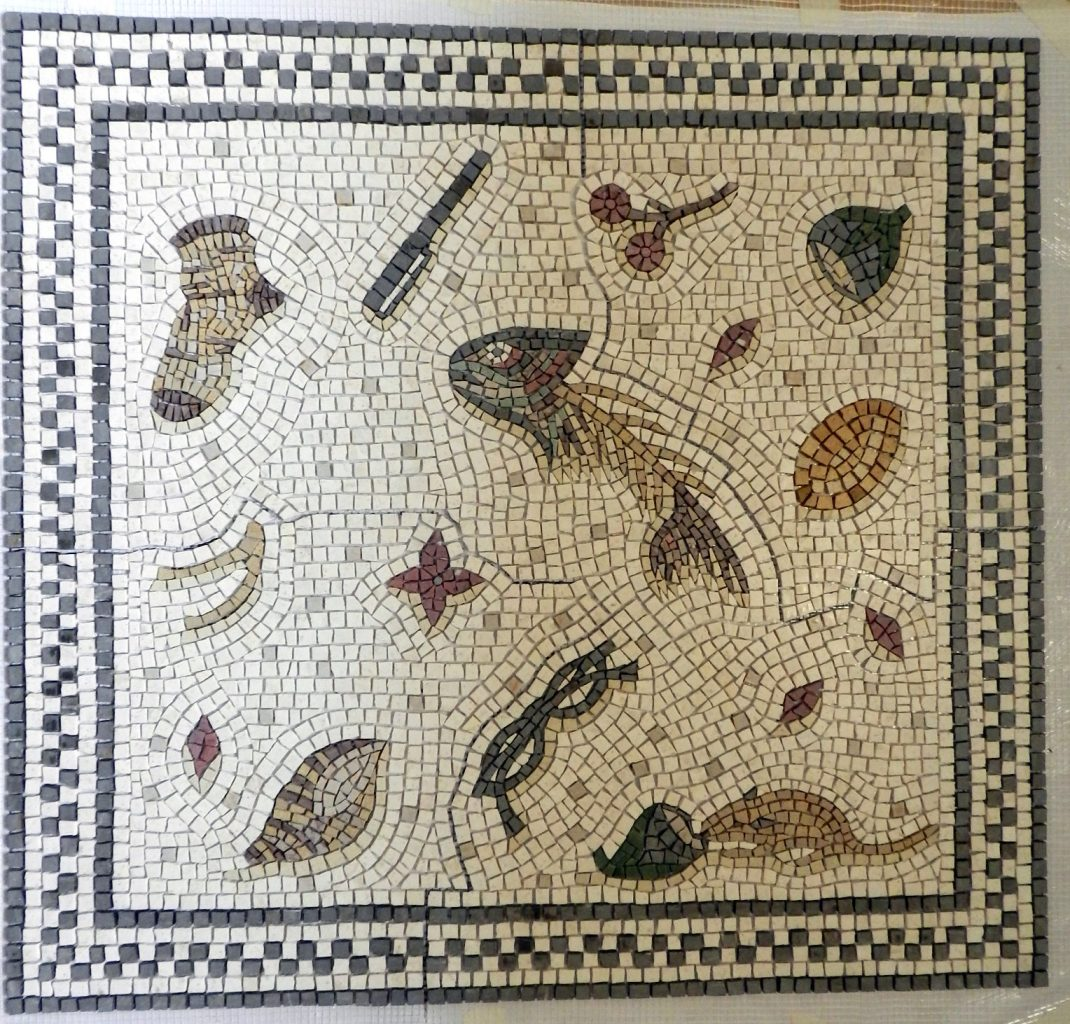 The unswept floor mosaic is ready in the studio