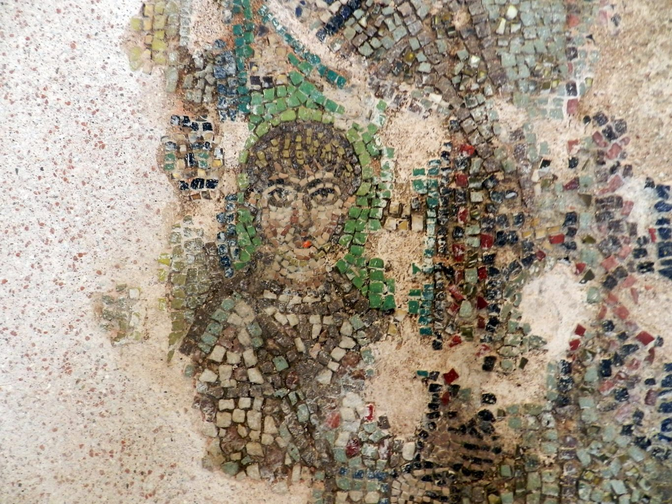 face detail of damaged byzantine mosaic