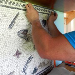 Installing the last section of the Unswept Floor mosaic