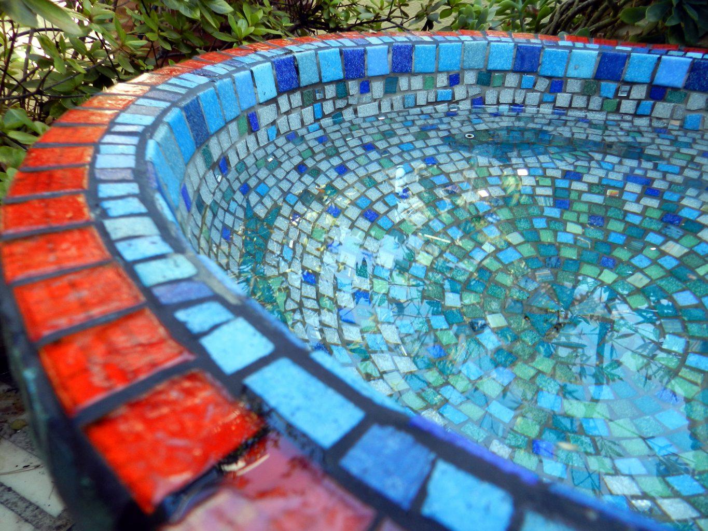 mosaic garden urn with fish detail