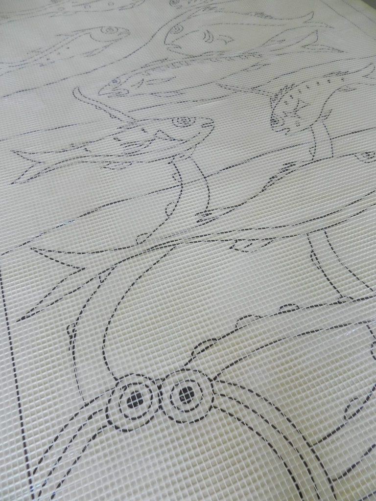 Octopus and fish mosaic _ design under mesh