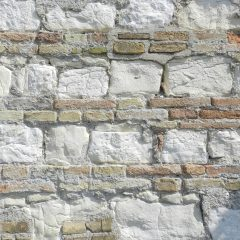 Wall with brick and stone, Ancona, Italy.