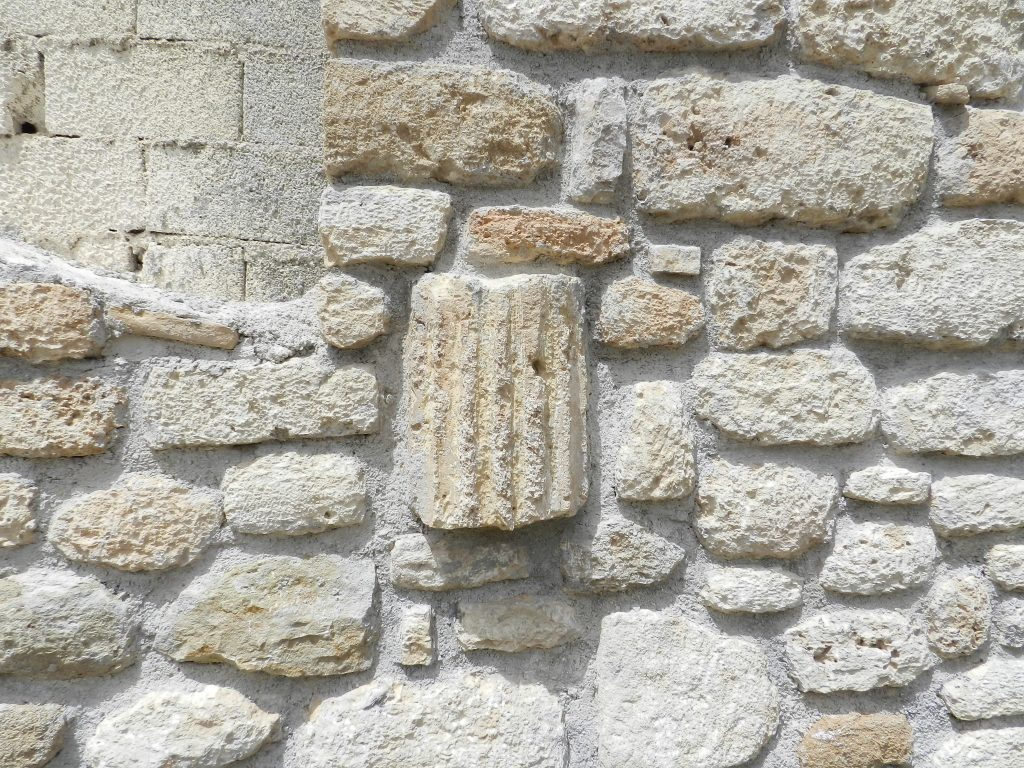 Village wall with breeze blocks and recylced stone, Corinth, Greece.