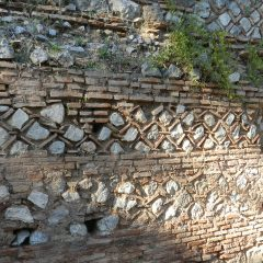 Delphi ornamental wall, Greece.