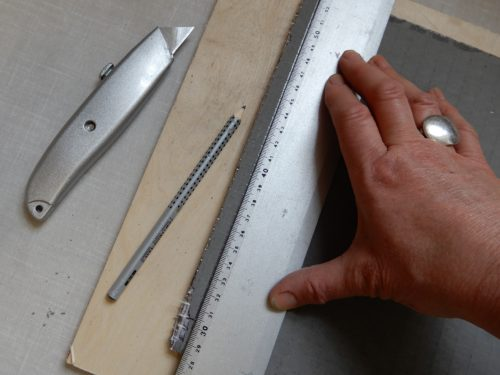 cutting Jackoboard for the tile adhesive method