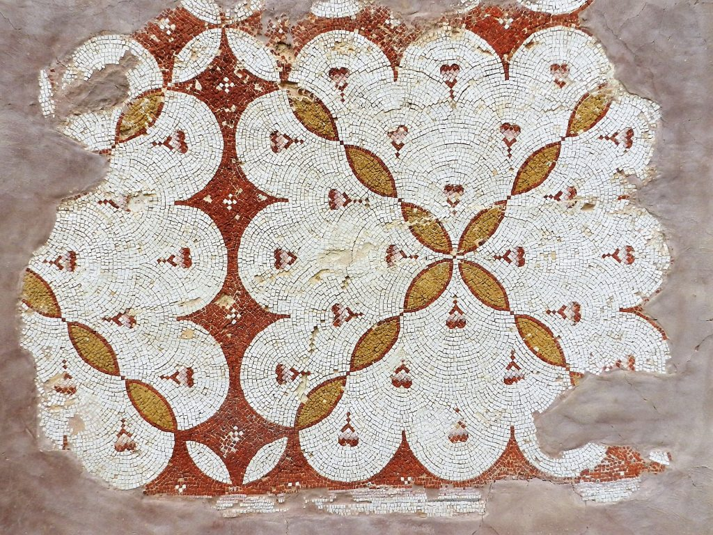 ancient mosaic fragment in yellow and red