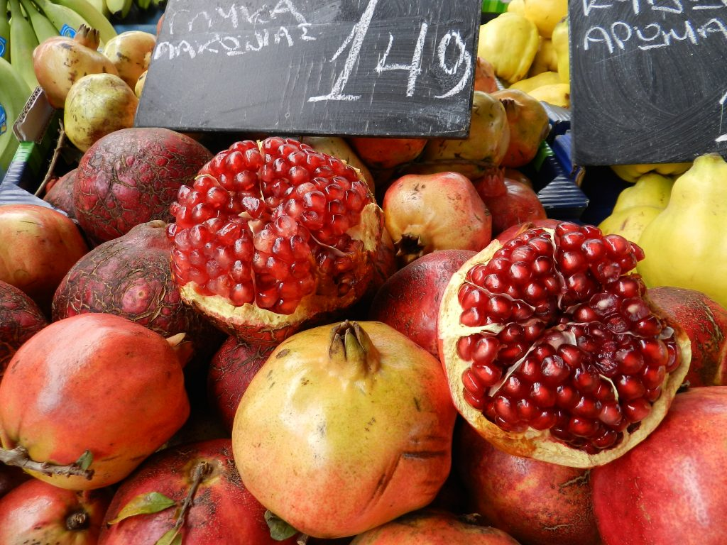 pomegranates in an athens market