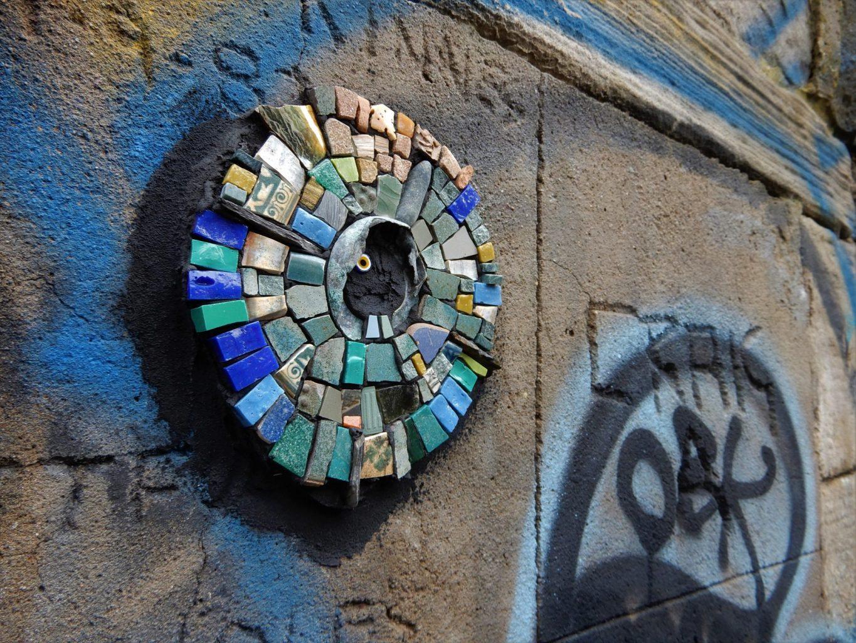 circular mosaic in blues, greens and yellows