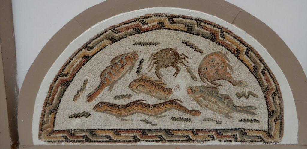 Semi circular mosaic of fish.